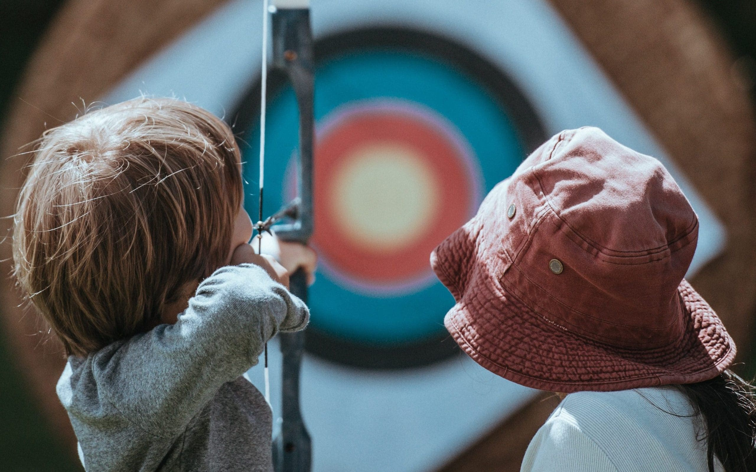 two children practising archery, a sunnah academy of sports archery course