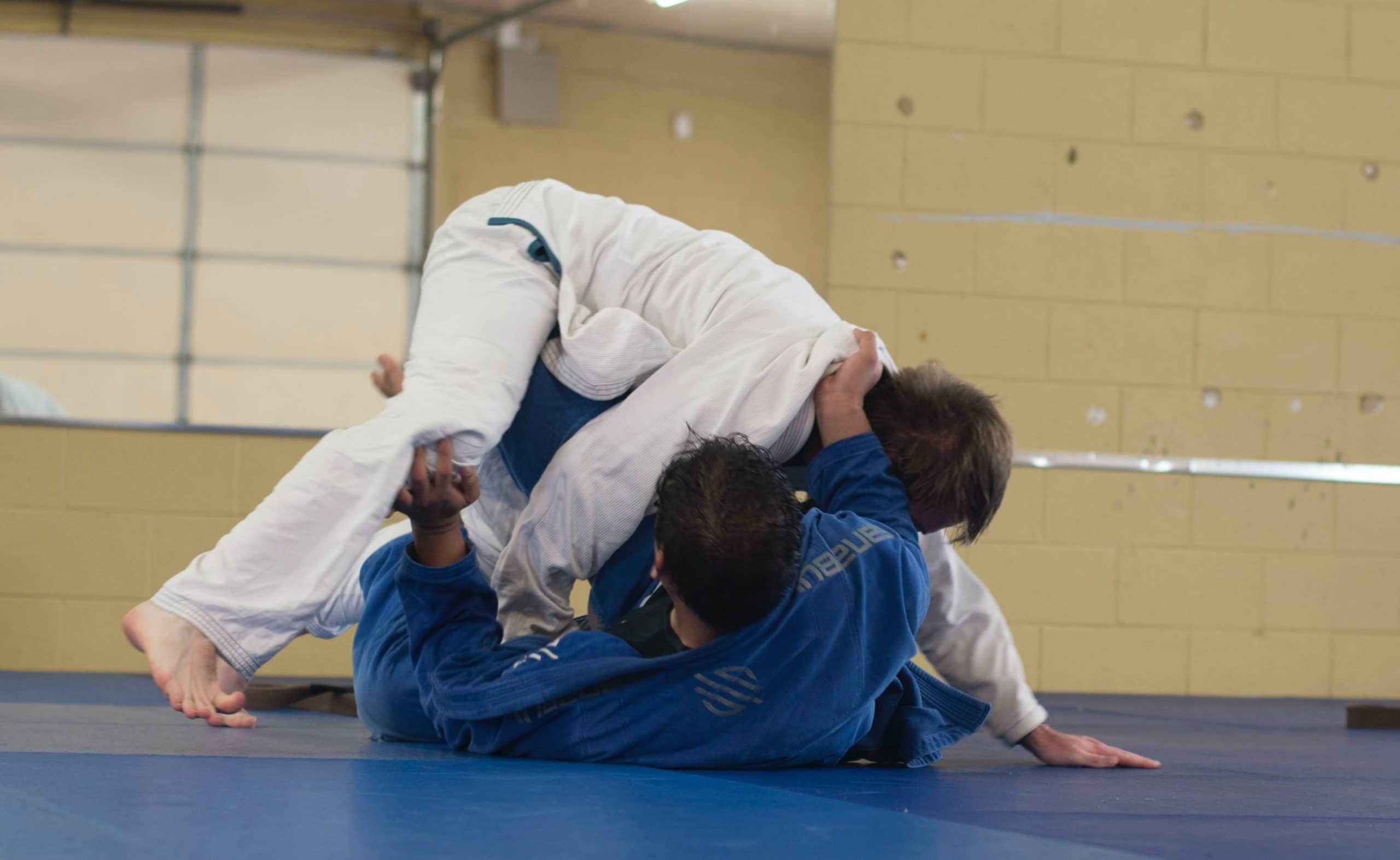 Martial Arts. Two men practising Brazilian jiu-jitsu for the sunnah academy of sports martial arts course